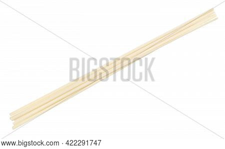 Few Dried Round Udon Noodles From Wheat Flour Isolated On White Background