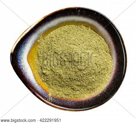 Top View Of Milled Stevia Rebaudiana Herb (natural Sugar Substitute) In Ceramic Bowl Isolated On Whi
