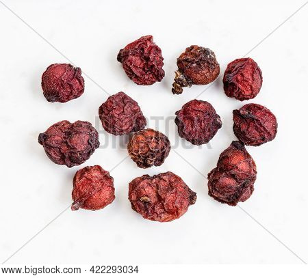 Few Dried Magnolia Berries (schisandra Chinensis Fruits) Close Up On Gray Ceramic Plate