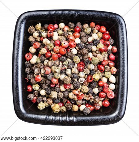 Top View Of Four Pepper Blend Peppercorns In Black Bowl Isolated On White Background