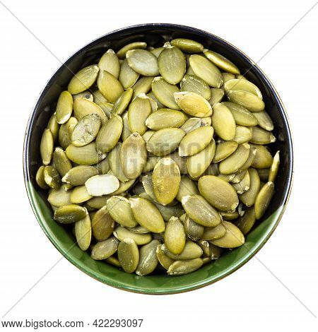 Top View Of Hulled Pumpkin Seeds In Round Bowl Isolated On White Background