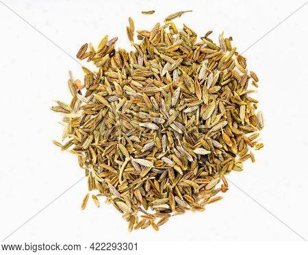 Top View Of Pile Of Cumin (cuminum Cyminum) Seeds On Gray Ceramic Plate