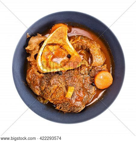 Top View Of Portion Of Ossobuco (beef Shin Braised With Vegetables, Wine And Broth) In Gray Bowl Iso