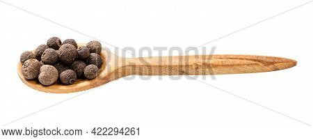 Wooden Spoon With Allspice Jamaica Peppers Isolated On White Background