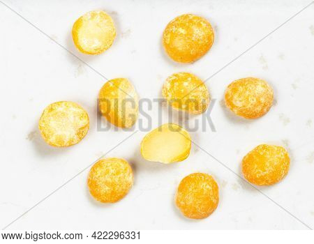 Several Raw Dried Split Yellow Peas Close Up On Gray Ceramic Plate