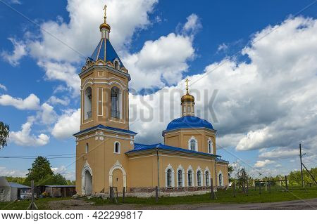 Restored Ancient Orthodox Church With A Blue Roof And Golden Domes.