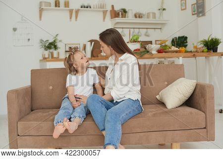 A Young Mother Is Talking Heart To Heart With Her Child. The Psychologist Communicates With A Little