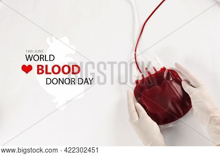 World Donor Day. Doctor In Gloves Holding Blood Pack On White Background, Top View