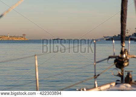 Photo From The Bow Of The Yacht To The Exit From The Bay. On The Horizon You Can See A Submarine Pas