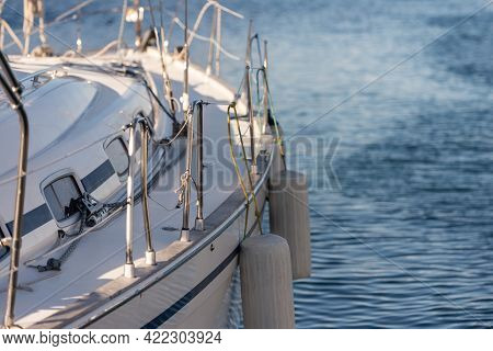 Yacht Side With Mooring Fenders. The Side Of The Yacht In The Parking Lot Is Made From The Stern Sid