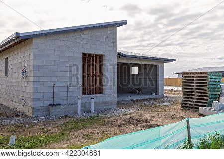 Mackay, Queensland, Australia - May 2021: A House Being Constructed From Concrete Blocks On Suburban