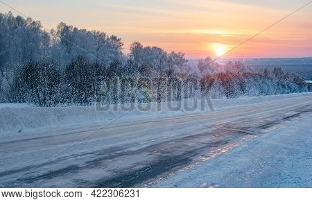 Winter, Frosty Morning Landscape Of The Rising Sun With Sun Glare On The Background Of A Slippery, I