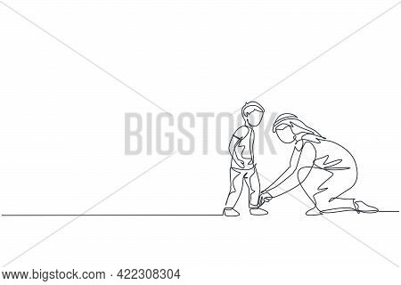 One Continuous Line Drawing Of Young Arabian Dad Help His Son To Tie Shoelaces Before Go To School.