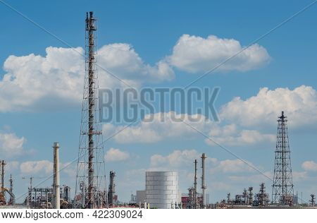 Oil Refinery Or Petroleum Refinery Plant With Blue Sky Background. Power And Energy Industry. Oil An