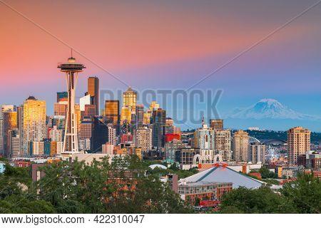 Seattle, Washington, USA downtown skyline at twilight with Mt. Rainier.