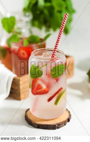 A Refreshing Summer Drink With Strawberries, Lemon And Mint In A Glass On A Light Background. Strawb