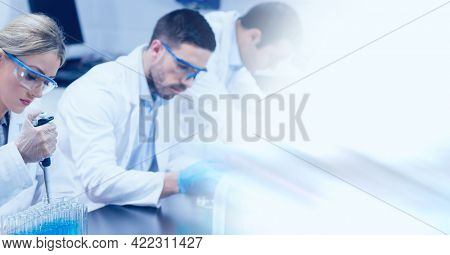 Composition of male and female lab technicians at work, with blurred copy space to right. medical and science research concept digitally generated image.