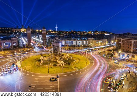 BARCELONA, SPAIN - MARCH 23, 2019. Plaza de Espana after the sunset with a long exposure and visible light trails of passing vehicles. Catalonia, Spain