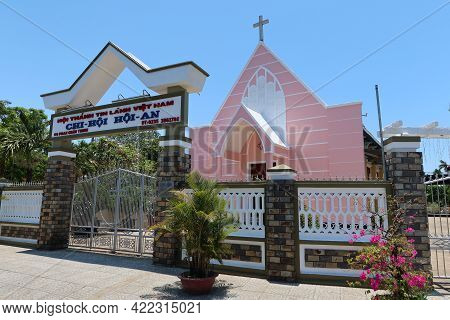 Hoi An, Vietnam, May 23, 2021: Main Entrance And Pink Facade Of The Evangelical Church In Hoi An, Vi