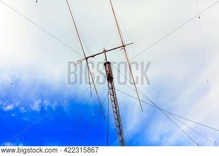 Ham Radio Antenna Against Cloudy Sky Outdoors
