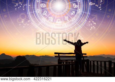 Woman Raising Hands Looking At The Sky. Astrological Wheel Projection, Choose A Zodiac Sign. Trust H