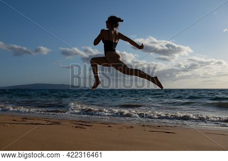 Woman Run On The Beach. Active Sporty Girl Running Along Ocean Surf By Water Pool To Keep Fit And He