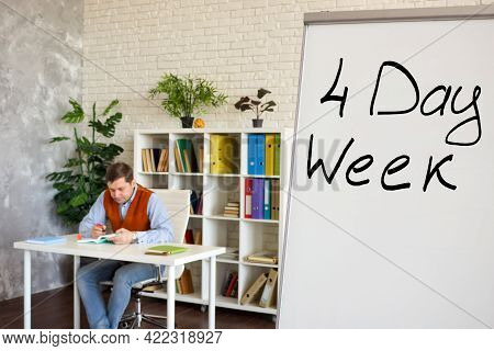 Sign Four Day Week For Work In The Office On The Whiteboard.