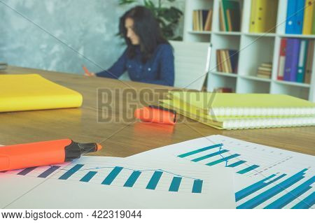 Financial Report With Charts On The Office Desk. Paperwork And Bookkeeping Concept.