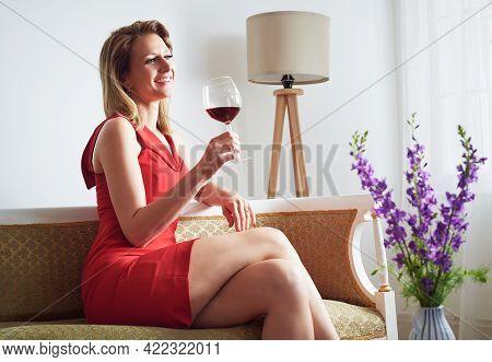 Beautiful woman portrait with wine. Beauty Woman face Portrait. Beautiful model woman portrait. Stylish woman portrait with glass of wine. Beautiful woman portrait. Woman fashion portrait. Woman drinking wine. Woman beauty fashion portrait. Red wine.