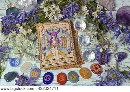 Still Life With High Priestess Card Of The Old Tarot Deck On Witch Altar Table With Chakra Crystals