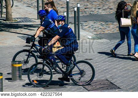 Reims France May 31, 2021 Policeman On Bicycle Patrolling Downtown Reims During Deconfinement In Ord