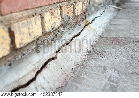 Crack In The Foundation Of The House.