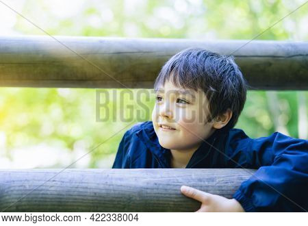 Cute Boy With Smiling Face Looking Out, Candid Shot Happy Kid Playing In The Park,child Having Fun I