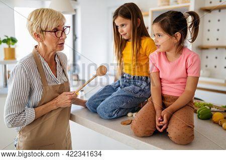 Grandmother Is Scolding Her Grandchildrens Girls. Family, Punishment, Discipline Concept