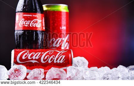 Bottle And Cans Of Coca-cola