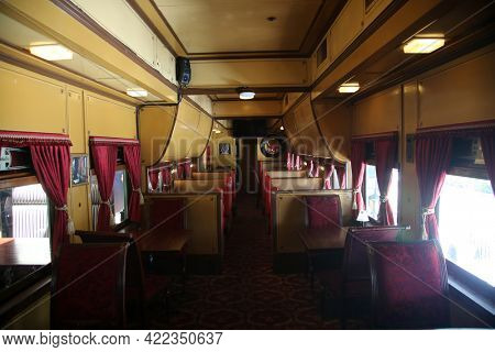 May 26, 2021 San Juan Capistrano, California: Inside an antique Train Rail Car showing the luxury of travel from the 1800's. Editorial.