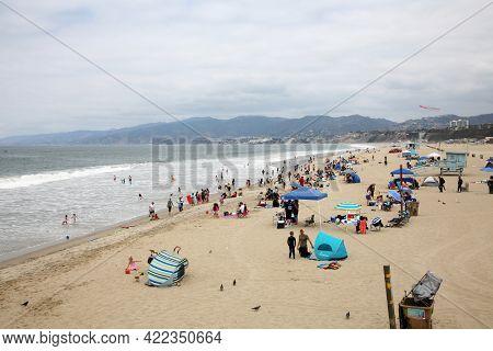 May 14, 2021 Santa Monica California, USA: Santa Monica California Beach. People enjoy the day at the beach in Santa Monica California. Editorial Use.