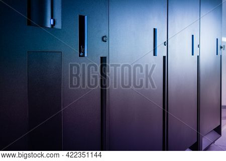 row of server cabinets with detail on door lock as internet security abstract