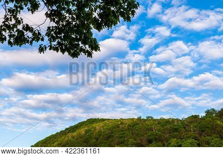 Blue Summer Skies With White Cirrocumulus Clouds Above A Forested Hillside In The Allegheny Nation F