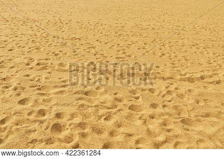 Dark Yellow Sand Background, Sunny Seashore, Beach Landscape.