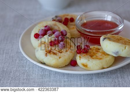 A Healthy Breakfast Of Cottage Cheese Pancakes, Syrniki With Red Currants And Close-up In A Plate On