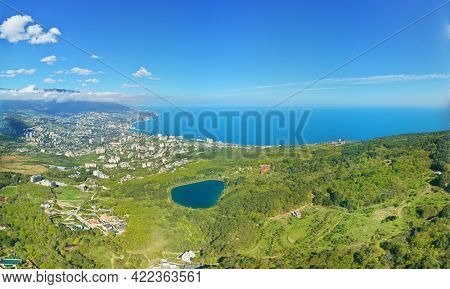 Aerial view of Yalta magabi lakes. Spring mountain forest, and sea shore.
