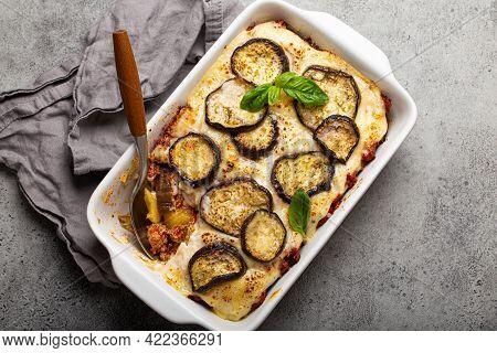 Greek Mediterranean Dish Moussaka With Baked Eggplants, Ground Beef In White Ceramic Casserole On Ru