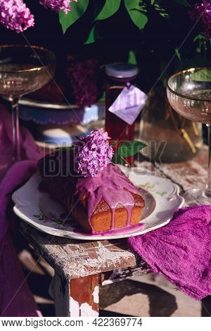 Lavender Glaze Cake On A Table In A Spring Garden..style Vintage.selective Focus