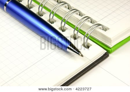 Notebook And A Pen Close-Up