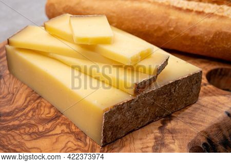 French Food -  Piece Of Cheese Comte Made From Cow Milk In Region Franche-comte In France And Fresh