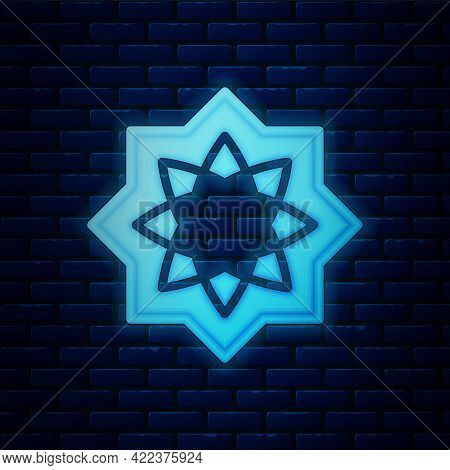 Glowing Neon Islamic Octagonal Star Ornament Icon Isolated On Brick Wall Background. Vector