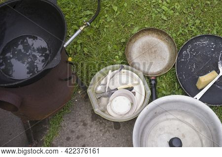 Washing Dirty Cookware Outdoor, Overhead Shot Without People