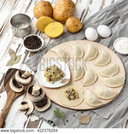 Dumplings Stuffed With Mashed Potatoes And Mushrooms. Cooking Process. Filling On Raw Dough Circles