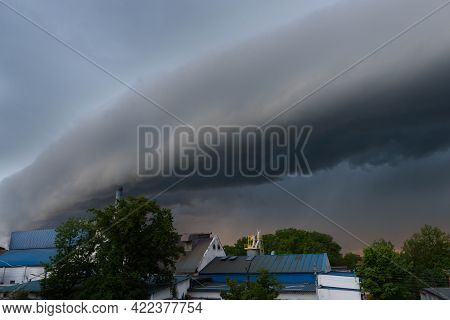Completely Cloudy Sky Covered With Dark Clouds. A Squall Shaft, Also Known As A Shelf Cloud, Is Visi